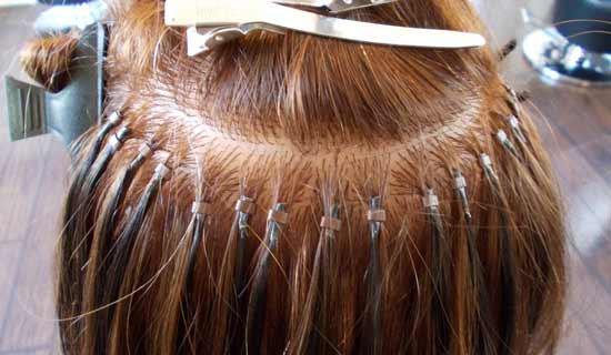 extensiones que se aplican entretejiendo al pelo de la persona