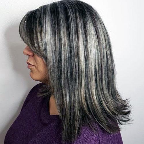 pelo castaño oscuro con algunas canas