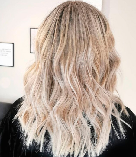 balayage from dark blonde roots to very light blonde roots