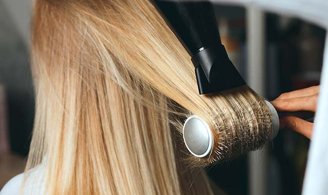 blonde hair thinned by continuous bleaching